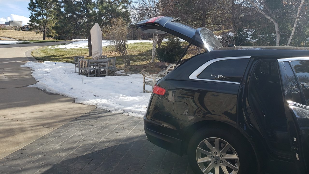 private black car picking up a customer from Denver DTC