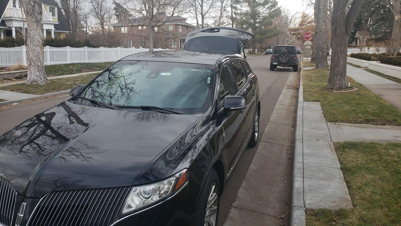 luxury black sedan, ride from Denver International Airport