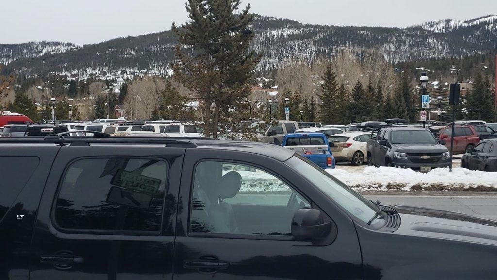 Black SUV at Breckenridge ski resorts main parking lot
