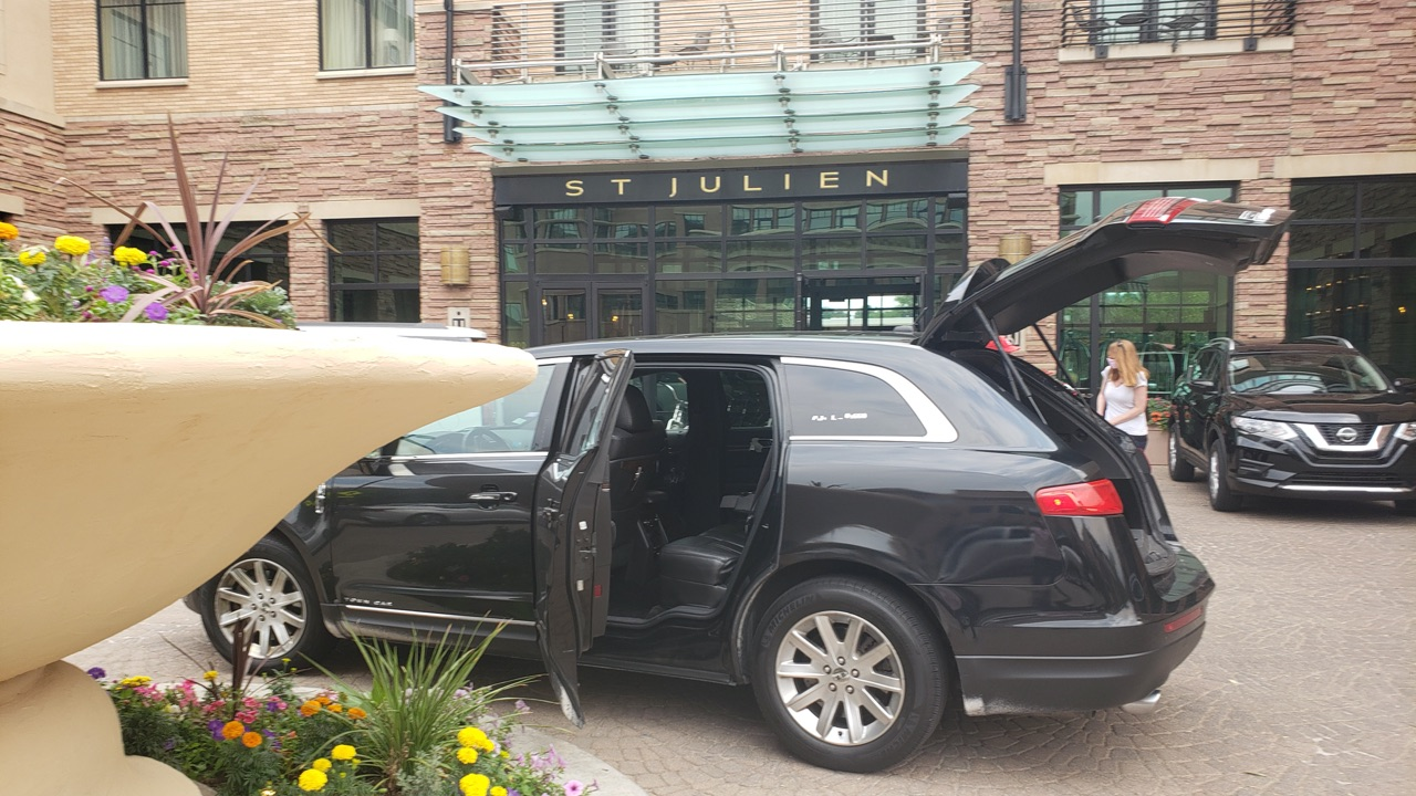 town car waiting for a ride outside St Julien Hotel Boulder Colorado