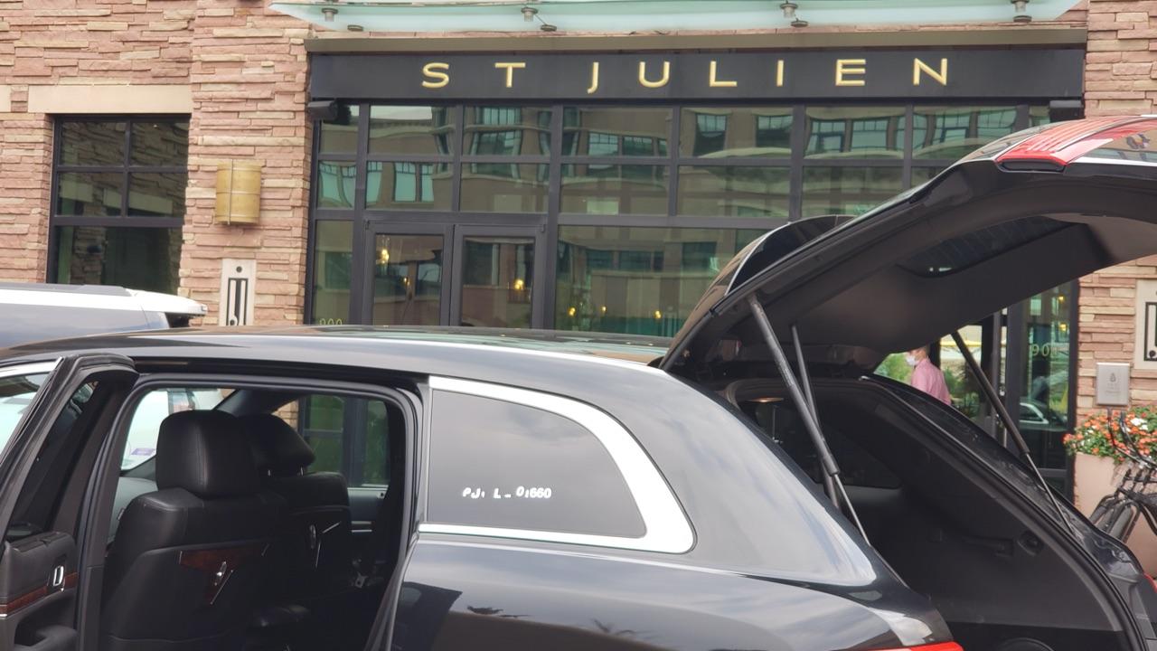 black sedan outside Sj Julien Hotel Boulder