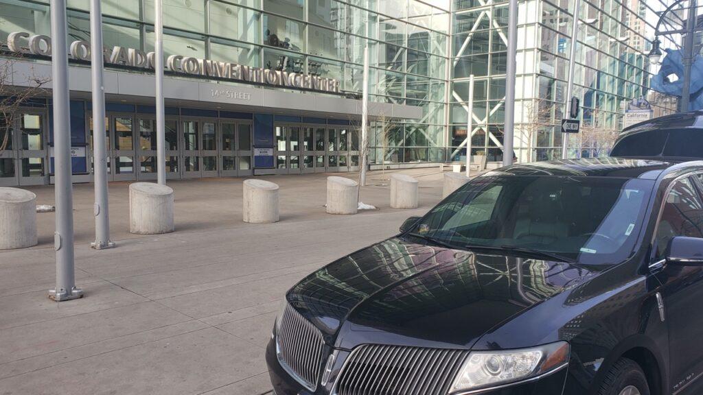 black car waiting for customer at Convention Center Denver