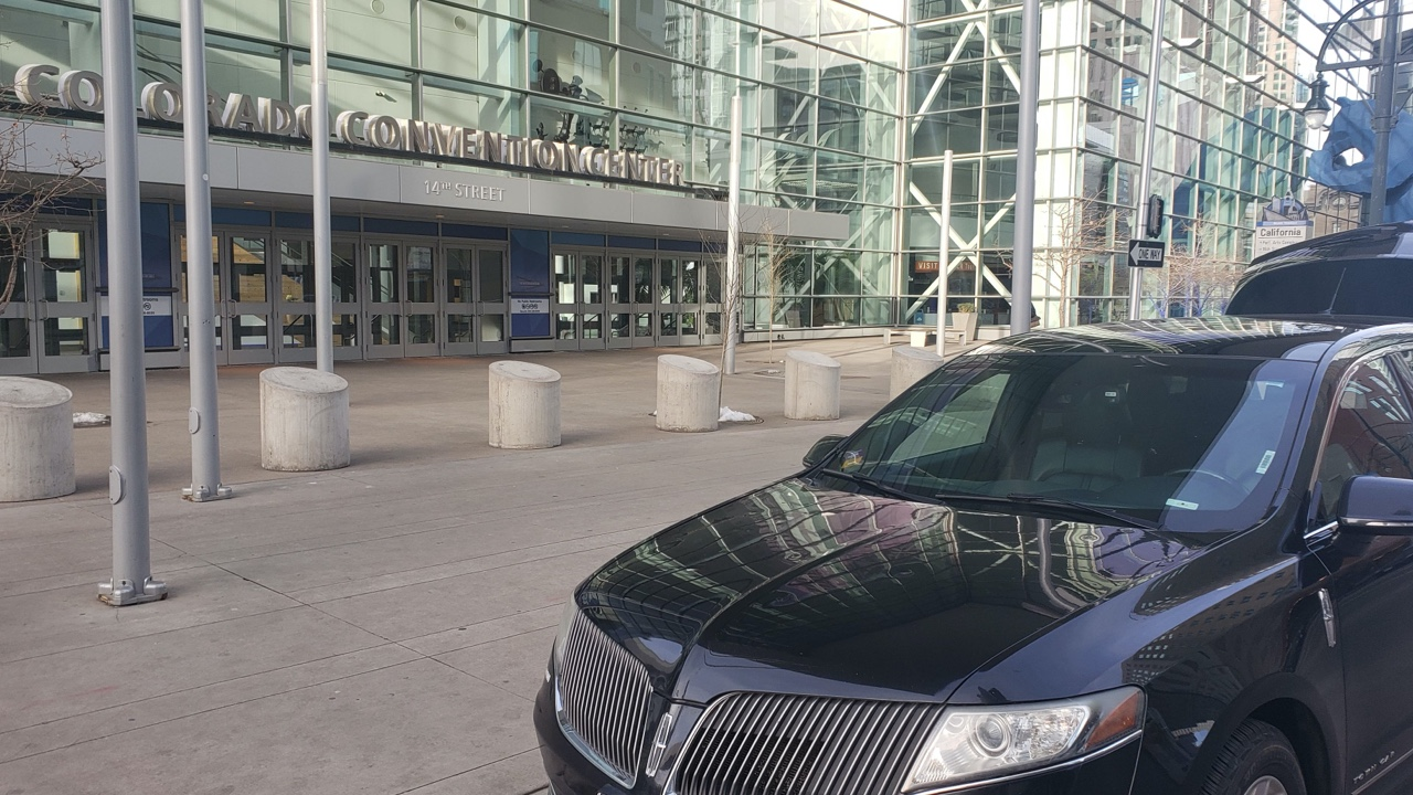 black car waiting for customer at Convention Center Denver