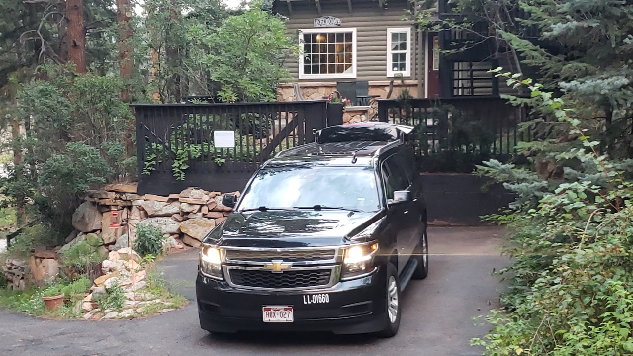 black SUV waiting for a ride outside a private residence at Evergreen Colorado